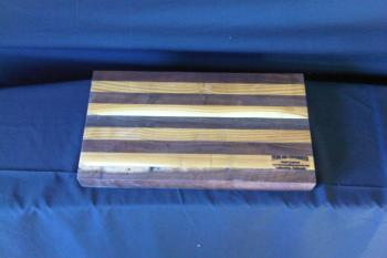 "This medium cutting board measures approximately 16"" x 9"" x 1.5"". It is made of sustainably harvested black walnut, and olive wood from Boulder County, Colorado"