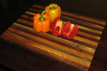 This large cutting board is made of sustainably harvested black walnut, and olive wood from Boulder County, Colorado.